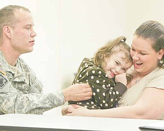 Four-year-old Mackenize Snyder of Sharon, Pa., giggles as her uncle, Army Reserve Spec. Douglas Ferguson, tickles her. She is in the arms of her mother, Amanda Snyder, Ferguson's sister. Mackenize was 2 when her uncle deployed to Afghanistan.
