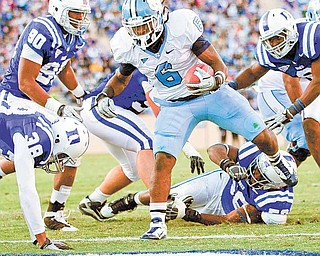 North Carolina's Anthony Elzy (6) steps into the end zone to score a touchdown in the first quarter against Duke during an NCAA college football game Saturday, Nov. 27, 2010, in Durham, N.C.