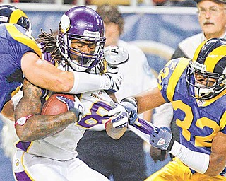 Donovan Fletcher's brother, Bradley (32), moves in for a tackle on Vikings receiver Sidney Rice in a 2009 game.