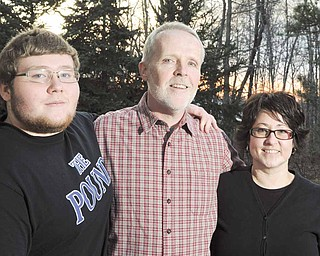 Ron Elkins, a retired career foreign service officer who was stationed in Europe and Africa, is happy to be home again in his native Poland, Ohio, with his wife, Natalie, and their son, Caleb, who will graduate from Poland Seminary High School in June.