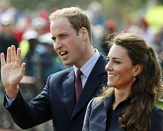This Monday April 11, 2011 file photo shows Britain's Prince William accompanied by his fiancee Kate Middleton, as they arrive at Witton Country Park, Darwen, England. The full list of confirmed guests attending the royal wedding of Prince William and Kate Middleton was released by Britain's monarchy Saturday April 23, 2011. Soccer star David Beckham and his wife Victoria were among the most recognizable names on the list of guests at the April 29 nuptials. Royal family members from countries including Bahrain, Denmark, Spain and Morocco will also attend. Other guests include government officials, Afghan war veterans, and charity workers.