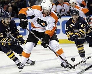 Philadelphia Flyers' Scott Hartnell (19) battles for the puck with Buffalo Sabres' Nathan Gerbe (42) and Patrick Kaleta (36) during the second period in Game 6 of a first-round NHL Stanley Cup playoffs hockey series, in Buffalo, N.Y., Sunday, April 24, 2011.