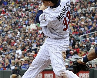 Minnesota Twins' Justin Morneau hit his second single of the baseball game in the eighth inning against the Cleveland Indians, Saturday, April 23, 2011, in Minneapolis where the Twins won 10-3. Morneau hit a two-run single earlier in his return to the lineup.