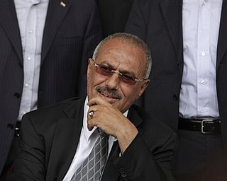 Yemeni President Ali Abdullah Saleh smiles while looking at  his supporters, not pictured, during a rally in his support, in Sanaa,Yemen, Friday, April 22, 2011. Opponents and supporters of Yemen's embattled president are marching in cities and towns across the nation for rival rallies after Friday prayers.