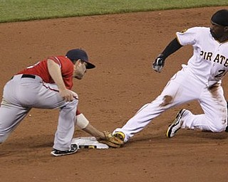Washington Nationals shortstop Danny Espinosa, left, tags Pittsburgh Pirates' Andrew McCutchen as he tries to steal  second in the sixth inning of the baseball game, Saturday, April 23, 2011, in Pittsburgh. McCutchen was called safe and came around to score as the Pirates won 7-2.