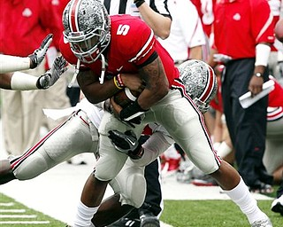 Ohio State quarterback Braxton Miller (5) is tackled by Nate Oliver during an NCAA college football Spring Game, Saturday, April 23, 2011, in Columbus, Ohio.