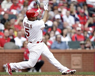 St. Louis Cardinals' Albert Pujols (5) connects for a solo home run in the sixth inning of a baseball game against the Cincinnati Reds, Saturday, April 23, 2011, in St. Louis. The Reds defeated the Cardinals 5-3.