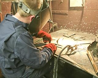 ROBERT K. YOSAY | THE VINDICATOR..Michael Cherol test welds two pieces of metal -  .-30-