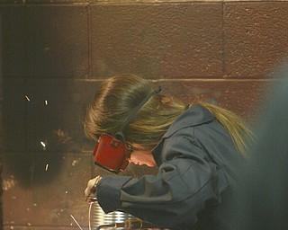 ROBERT K. YOSAY | THE VINDICATOR..Taralynn Gilkinson a senior  gas welds a piece of metal as part of her class project in Mr Bob Day's Welding Class - ..-30-