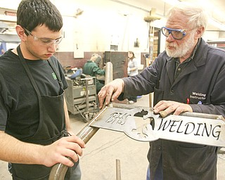 ROBERT K. YOSAY | THE VINDICATOR..Checking a weld on a Canfield Fair Bench Michael Cherol and Bob Day -  The industrial arts program has made and supplied over a 100 benches for the Canfield Fairgrounds -  ..-30-