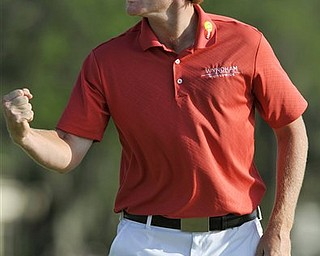 Brandt Snedeker celebrates his putt on the first playoff hole to tie Luke Donald on the 18th green and force a second playoff during the The Heritage golf tournament in Hilton Head Island, S.C., Sunday, April 24, 2011. Snedeker finished the tournament 12-under.