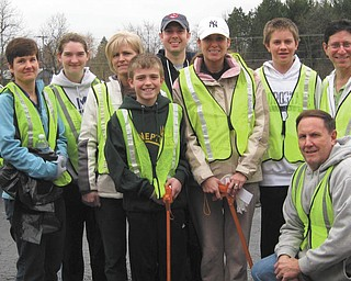 Clean-spirited club members: Members of the Rotary Club of Austintown joined forces with the Fitch Interact Club for a semiannual cleaning of Kirk Road from Route 46 to Whispering Pines Drive, which is about 11⁄2 miles. The task has been undertaken twice a year for the past 10 years. The weather was cold and damp, but the volunteers kept up their spirit for improving the community. They are, standing, from left, Hillary Prestridge, Kaitlin Choma, Tina Kubacki, Todd Kubacki, Brian Laraway, Heather Fronk, David Dalvin and Dr. Mitch Dalvin; and kneeling is Gary Reel.