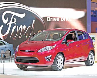 In this Jan. 11, 2010 file photo, a 2011 Ford Fiesta is displayed at the North American International Auto Show, in Detroit. Ford posted its best first-quarter profit in 13 years, as its new, more fuel-efficient vehicles reached showrooms during a surge in gasoline prices. New arrivals such as the Ford Explorer and Fiesta small car are selling well.
