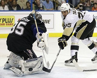 Pittsburgh Penguins center Maxime Talbot (25) is stopped by Tampa Bay Lightning goalie Dwayne Roloson (35) during the third period in Game 6 of a first-round NHL Stanley Cup playoff series Monday, April 25, 2011 in Tampa, Fla.