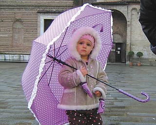 Mary Jane Montgomery sent this picture of her granddaughter, Gracie Guoan, 2 1/2, who is living in Naples, Italy, with her military family. She noted that spring is quite chilly and rainy there, too.