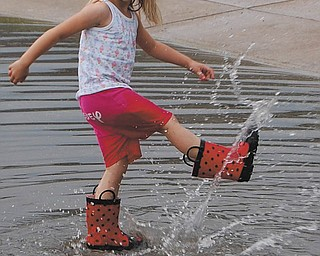"Sally Jones of Canfield says her daughter, Lindsay, 5, could to be singing, ""These Boots Are Made For Splashing."""