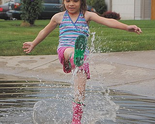 """What else is there to do with rainboots than splash?"" is what Samantha Jones, 6, says to her mom, Sally Jones of Canfield, after a May 2010 rainstorm."