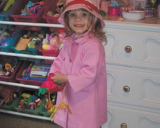 Olivia Rossi of Austintown picked out her own clothes to wear to go out and splash in the puddles!