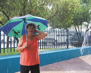 Ruth Burns of Poland thought a trip would get her away from the Ohio rain. However, the rain followed her all the way to the Bahamas, yet she kept on smiling! Photo submitted by her daughter, Laurie Fox of Lowellville.