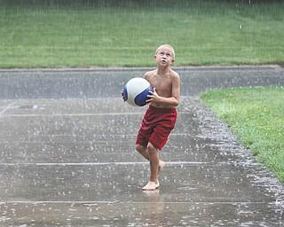 A little rain didn't stop Jimmy Goske of Boardman from having a ball.