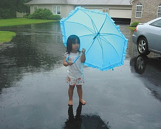 Norma Remias of Canfield sent this picture of her granddaughter, Jenni-Lin Remias of Poland, who was having a great time playing in the rain at Grandma's house.
