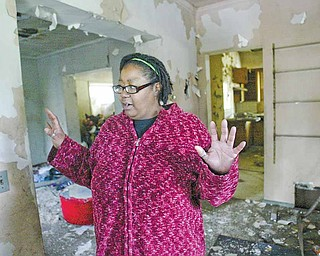 """Joyce Jones of Youngstown, mother of filmmaker Derrick """"D"""" Jones, walks through the home at 631 Ridge Ave., where she and her children once lived. Her son filmed a nine-minute documentary about the home, """"631,"""" that Derrick has shown in Youngstown several times in the past few years."""