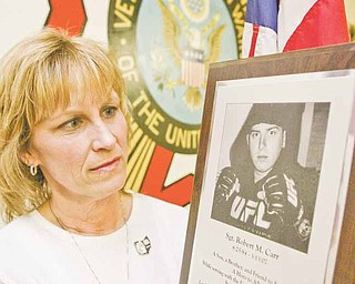 """Christine Wortman's son, Army Sgt. Robert """"Robbie"""" Michael Carr, a 2002 Champion High School graduate, was killed in Iraq on March 13, 2007. She says her son would have been proud that the military killed Osama bin Laden. The photo was taken Monday at Veterans of Foreign Wars Post 3332 in Newton Falls, where she works."""