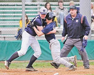 Lowellville's Louie Lebron (15) runs into Leetonia pitcher Lance Tullis (7) as he tries to score on a wild throw to home that Tullis misplayed during an Inter Tri-County League Tier Two game Monday at Cene Park in Struthers. The Rockets downed the Bear, 5-0.