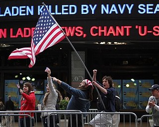 Melissa LaCour, left, Brittany McGarry, second from left, Bryan Murray, second from right, and Dennis Vincent celebrate outside the ABC studio in New York's Times Square as news of Osama bin Laden's death is announced on the ticker,  Monday, May 2, 2011.