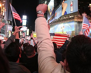 People in New York's Times Square react to the news of Osama Bin Laden's death early Monday morning May 2, 2011. President Barack Obama announced Sunday night, May 1, 2011, that Osama bin Laden was killed in an operation led by the United States.