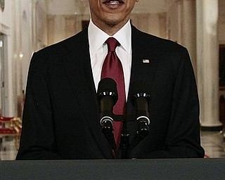 President Barack Obama reads his statement to photographers after making a televised statement on the death of Osama bin Laden from the East Room of the White House in Washington, Sunday, May 1, 2011.