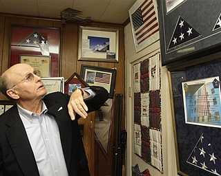 Mike Low, father of 911 World Trade Center victim American Airlines flight attendant Sara Low, describes flags sent to his family that have been flown in honor of his daughter over Afghanistan by members of the U.S. military at a wall displaying memorabilia of his daughter in his Batesville, Ark., office Monday, May 2, 2011. Osama Bin Laden, the face of global terrorism and mastermind of the Sept. 11, 2001, attacks, was tracked down and shot to death Monday in Pakistan by an elite team of U.S. forces, ending an unrelenting manhunt that spanned a frustrating decade.