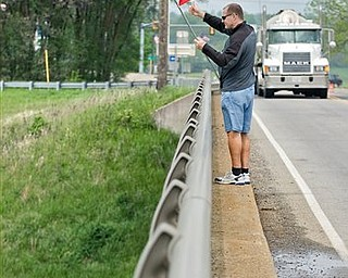 Gary Ruebush of Harrisonburg, Va., waves an American flag to Interstate 81 drivers on the Lance Corporal Daniel Scott Resner Bubb Memorial Bridge, which was named after his nephew, who died in Iraq serving in the military. Ruebush wanted to honor all fallen soldiers after the news of the death of terrorist Osama bid Laden, the orchestrator of the Sept. 11 attacks on the US.