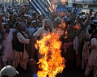 Angry supporters of Pakistani religious party Jamiat Ulema-e-Islam burn representation of the United States during a rally to condemn the killing of Osama bin Laden in Quetta, Pakistan on Monday, May 2, 2011.  al-Qaida chief  Osama bin Laden was slain in his hideout in Pakistan early Monday in a firefight with U.S. forces, ending a manhunt that spanned a decade.