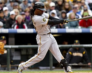 Pittsburgh Pirates' Andrew McCutchen (22) hits an RBI single, scoring Perdro Alvarez, on a pitch by Colorado Rockies' Esmil Rogers, during the fifth inning of a baseball game Sunday, May 1, 2011 in Denver. The Pirates won 8-4.
