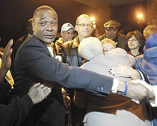 Doug Franklin won the Democratic nomination for Warren mayor Tuesday and celebrated at Enzo's Restaurant. Among them was current Mayor Michael O'Brien, center. Franklin, who would be Warren's first black mayor, defeated Jim Graham, president of UAW Local 1112.
