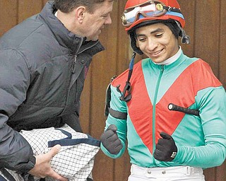 Trainer H. Graham Motion, left, shares a laugh with jockey Alan Garcia before he rode Animal Kingdom to a two-length victory in the $500,000 (Gr. III) Spiral Stakes horse race at Turfway Park race course in Florence, Ky., Saturday, March 26, 2011.