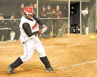 """Sarah Ingalls shortens up her swing to drive a pitch during a YSU softball game. Sarah, who is distantly related to """"Little House on the Prairie"""" author Laura Ingalls Wilder, said the hardest part about a prairie lifestyle would be giving up modern conveniences such as Facebook."""