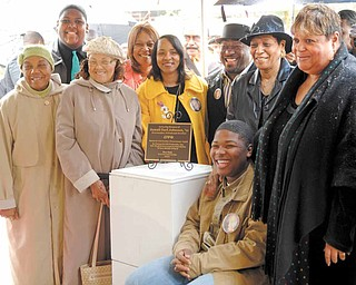 Family members of Jamail Johnson gather around the plaque that will rest under the tree planted in Johnson's memory. The plaque was dedicated by Johnson's fraternity, Omega Psi Phi, Woodrow Wilson Middle School and the Youngstown State University Student Government Association.