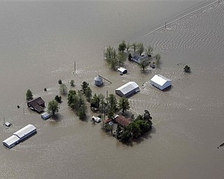 A farm is seen surrounded by floodwater Tuesday, May 3, 2011, in Mississippi County, Mo. The Army Corps of Engineers' blew a two-mile hole into the Birds Point levee in southeast Missouri, after nightfall Monday, flooding 130,000 acres of farmland in Missouri's Mississippi County in an effort to protect nearby Cairo, Ill.