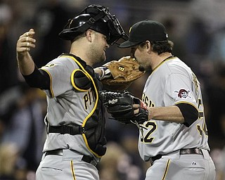 Pittsburgh Pirates closer Joel Hanrahan gets a hug from catcher Chris Snyder after closing out the Pirates 4-3 victory over the San Diego Padres in a baseball game Monday, May 2, 2011 in San Diego.