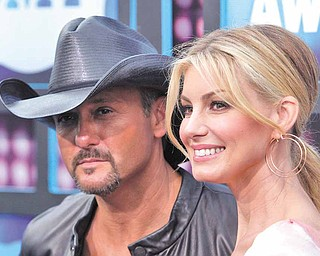 Country singers Faith Hill and Tim McGraw attend the 2010 CMT Music Awards, in Nashville, Tenn. on Wednesday, June 9, 2010.