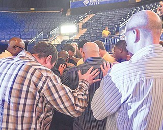 A group of men gather to pray at the Covelli Centre in  downtown Youngstown during the second annual Men's Rally in the Valley.