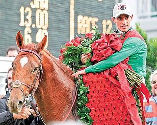 John Velazquez holds the Blanket of Roses after riding Animal Kingdom to victory during the 137th Kentucky Derby horse race at Churchill Downs Saturday, May 7, 2011, in Louisville, Ky.