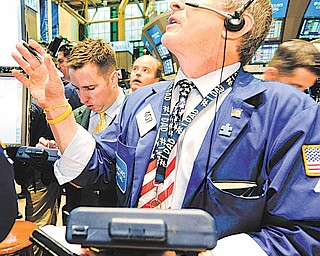 Richard Newman of Barclays Capital works on the floor of the New York Stock Exchange on the one year anniversary of the 'flash crash,' Friday, May 6, 2011, in New York.