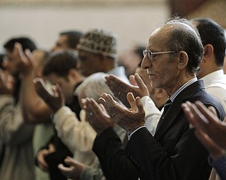 In this May 6, 2011 photo, Jebary Alsaade, right, and other Muslims prays at the Islamic Center of America in Dearborn, Mich. The killing of Osama bin Laden, a man who was America's face of evil for nearly a decade, left Christians, Jews and Muslims relieved, proud or even jubilant. For their religious leaders, it was sometimes hard to know just what to say about that. There is at least some dissonance between the values they preach and the triumphant response on the streets of New York and Washington to the death of a human being _ even one responsible for thousands of killings in those areas and around the world.