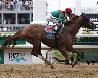 John Velazquez rides Animal Kingdom to victory during the 137th Kentucky Derby horse race at Churchill Downs Saturday, May 7, 2011, in Louisville, Ky.