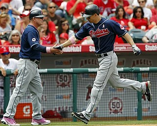Cleveland Indians center fielder Grady Sizemore, right, shakes hands with third base coach Steve Smith after hitting a solo home run against the Los Angeles Angels during the fifth inning of a baseball game in Anaheim, Calif., Sunday, May 8, 2011.