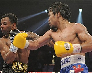 Manny Pacquiao lands a punch against Shane Mosley in the ninth round during a WBO welterweight title bout, Saturday, May 7, 2011, in Las Vegas.