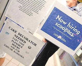 In this April 27, 2011 photo, a jobs hiring sign is posted at Baskin Robbins 31 Flavors ice cream store in Mountain View, Calif. Companies in March advertised the most jobs since the peak of the 2008 financial crisis, a sign that hiring is likely to remain healthy in the months ahead.